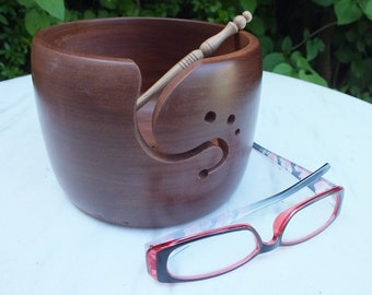 Yarn bowl hand turned from sapele wood with 3 holes and a curved notch for yarn. A beautiful and practical addition to any crafter's space.