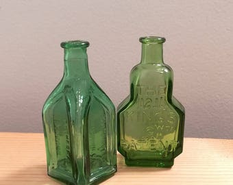 Two vintage Green Glass Wheaton Bottles, Kings Patent Balsam of Life and Cathedral Chief Wahoo Electric Tonic