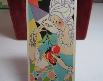 Gorgeous unused art deco 1930's colorful bridge tally card deco lady with star beauty mark in powdered wig holds large bunch of cherries