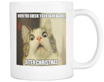 Christmas aftermath cat meme on 11 ounce coffee mug