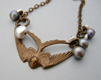 brass swallow necklace with pearls, soaring bird with freshwater pearls, freshwater pearl necklace
