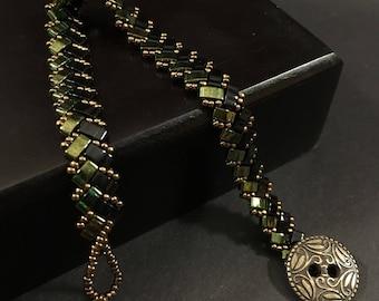Half Tila Beaded Bracelet - Emerald, Black and Bronze - 7 in