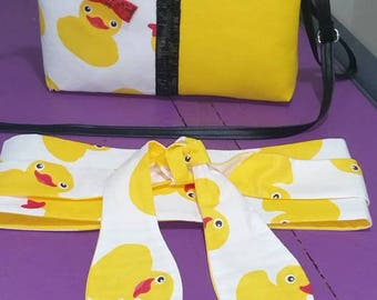 reversible fabric tie belt. ducks on one side and yellow on the other. Total length around 217 cm. to match