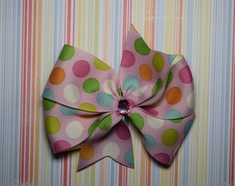 Pink multicolored dot bow