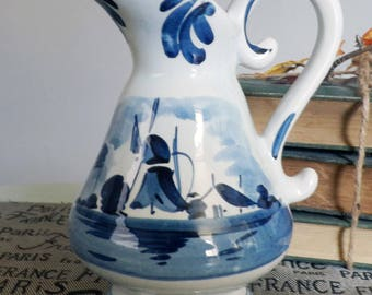 Vintage (1950s   1960s) hand-painted Delft   Delftware jug.  Made in Holland. Traditional Windmill scene and sailboats, blue florals.