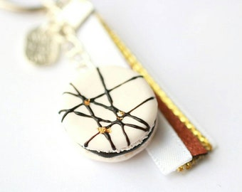 Keychain - realistic white macaroon decorated with chocolate sauce and gold leaf