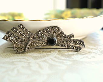 Sterling and marcasite brooch of a vintage hat with black stone.