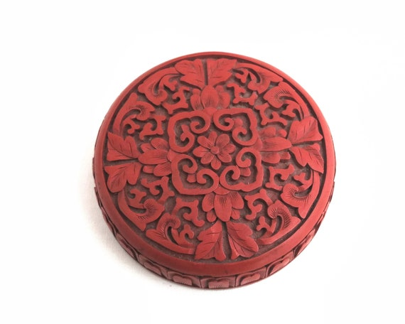 Vintage carved cinnabar colored lacquer jar, carved all over, lacquer on wood, pattern of flowers and leaves, fine workmanship, Chinese