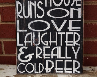 "HAND PAINTED DISTRESSED Typography Wooden Wall Art Sign ""This House Runs On Love Laughter And Really Cold Beer"""