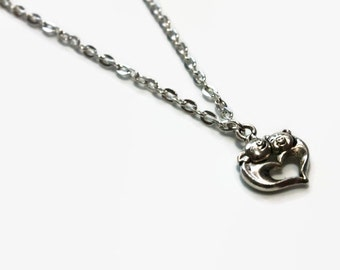 Silver pig necklace