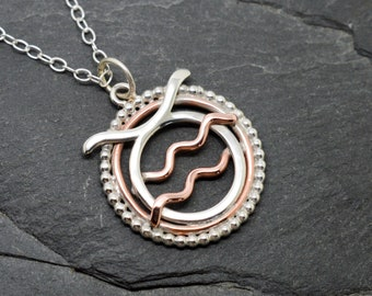 Taurus Aquarius necklace sterling silver and copper with beaded edging