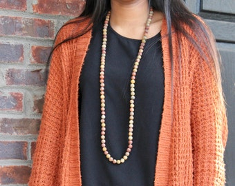 Long earth-tone beaded necklace