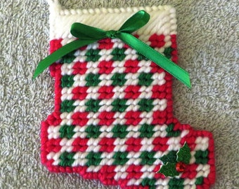 Handmade red and green Christmas stocking ornament.