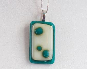 "Cute cream and green fused glass pendant  (1.25"" long), hangs on a 16"" silver box-type necklace. #203"