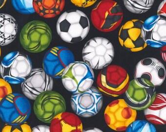 Soccerballs on black cotton fabric