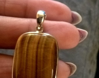 sterling silver tigers eye stone pendant