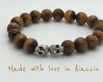 Bracelet.   Human skulls Tiger eye beads