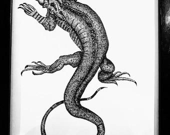 Ink drawing of Black Iguana, framed behind gkass