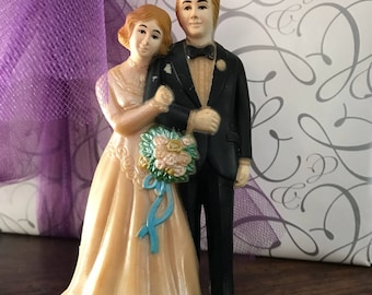 Vintage hard plastic brode and groom cake topper