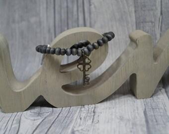 Bracelet gray elastic wooden beads