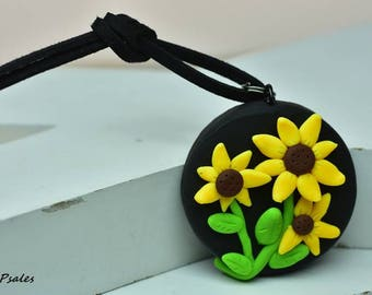 Floral Cameo Necklace, Hand Sculpted, Polymer Clay, Yellow flowers on round black pendant, black faux suede cording, black eyed susans