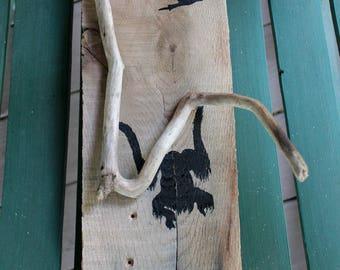 Orangutan and hornbill driftwood silhouette