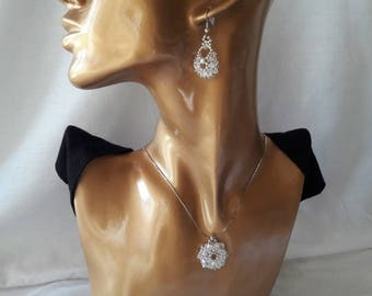 Set made with Swarovski Crystal and silver with 8 petal flower pendant and crystal flower