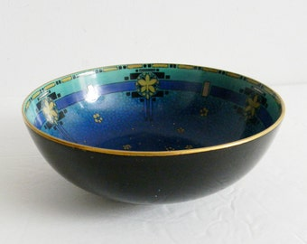 Royal Doulton decorative bowl with intricate designs - marked