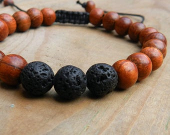 Adjustable bracelet, cotton thread, 23 bayong wood beads and 3 lava beads, 6mm.