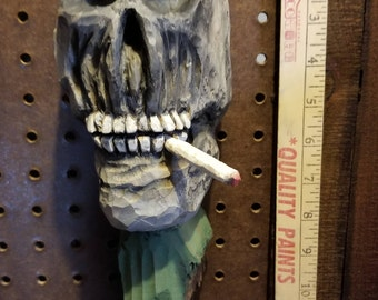 "Cottonwood bark "" skull"" Hand carved, painted and signed. Approx. 15 by 4 1/2 ins."