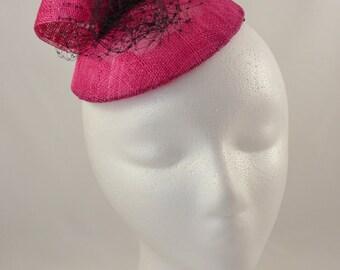 Hot pink fascinator with black veiling & hot pink loops embellishment