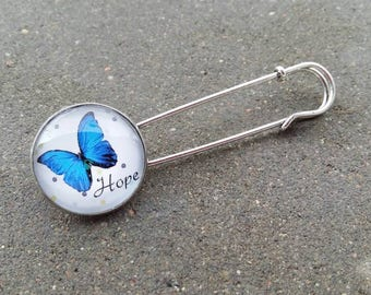 Butterfly metal cabochon and glass cabochon brooch