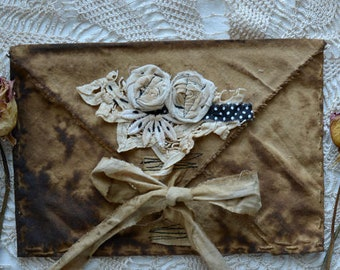 Primitive style, grungy ,vintage looking large embellished fabric envelope. Made to order.