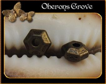 40 Metal beads 3x5mm bronze