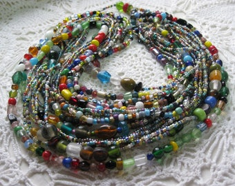 U- One Dozen Glass Mardi Gras bead necklaces from New Orleans-Carnival --Parade