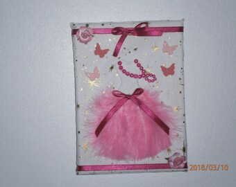 Frame with a little dress with feather
