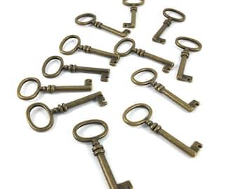 Set of 12 large charms key tone bronze
