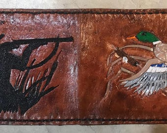 Hand made and tooled bifold wallets