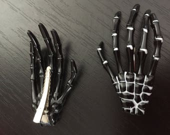 clips in the shapes of black skeleton hand hair