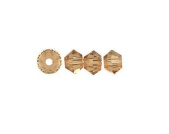 Swaovski Bicone bead light smoked topaz 3mm - Quantity of 45 beads
