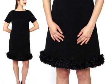 Vintage 1960s Black Scoopneck Short Sleeved Shift Dress with Ruffled Ribbon Hem | Medium/Large