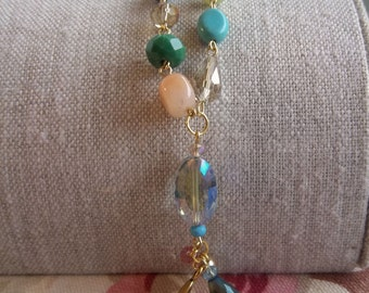 Delicate Springtime beaded necklace made with crystals, gemstones, glass, and pearl beads