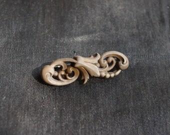 Antique gutta percha brooch