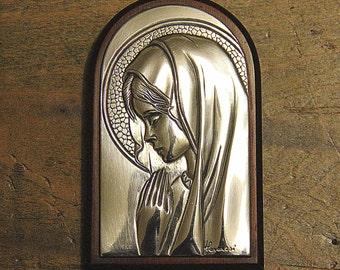 Sterling silver plaque of praying girl; signed 'Hesaresi' and hallmarked 925