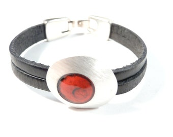Wristband bracelet featuring  sterling silver and red enamel