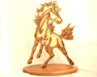 WILD horse on fretwork carved wooden base.