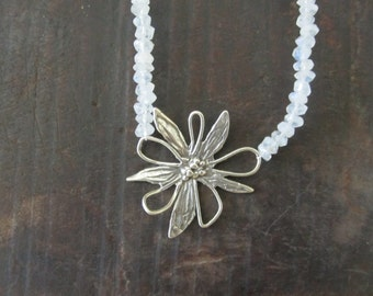 Moonstone beaded necklace with Sterling silver flower charm.