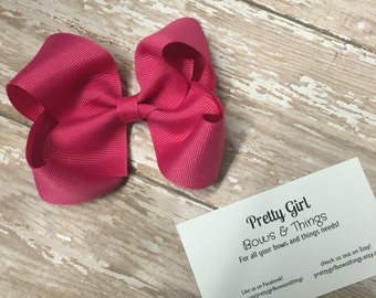 Shocking pink little girl bow
