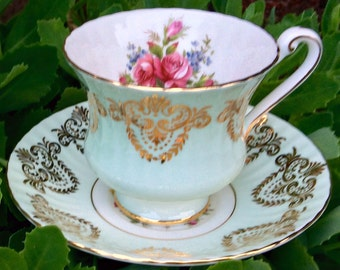 Gorgeous Pale Blue Paragon Teacup and Saucer with Red Roses