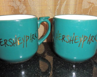Vintage Set of 2 Hershey Park Ceramic Forest Green & Gold Tone Colored Souvenir Coffee Mugs
